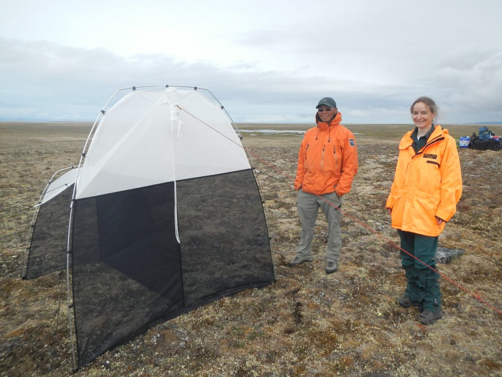 Terry Kalluk and Maryse Mahy, Parks Canada staff, taking care of our malaise trap in Sirmilik National Park