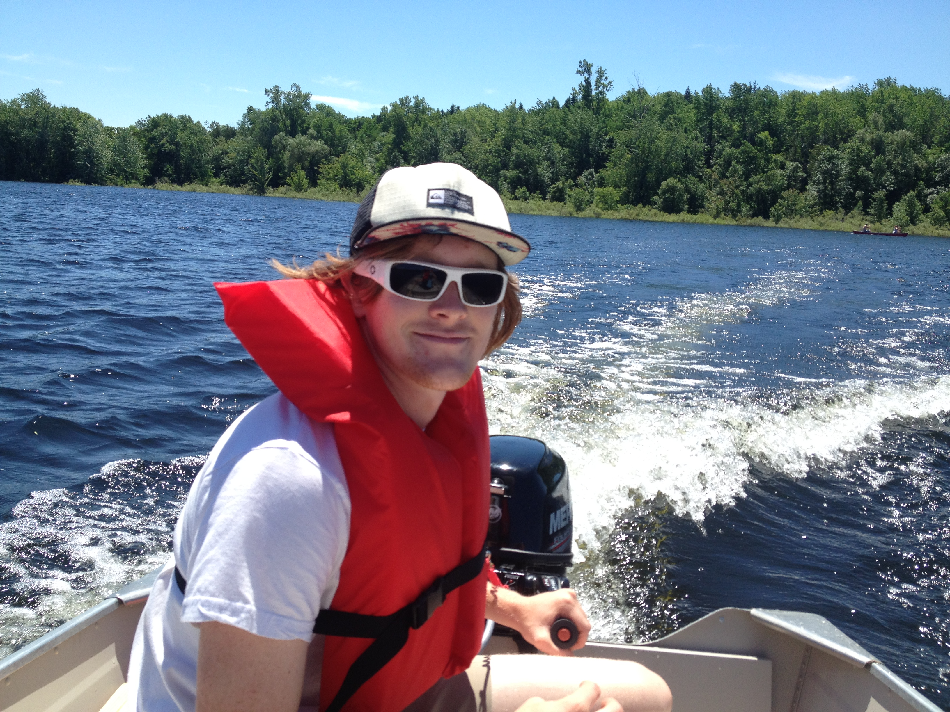 Driving the new boat in Belwood Lake Conservation Area