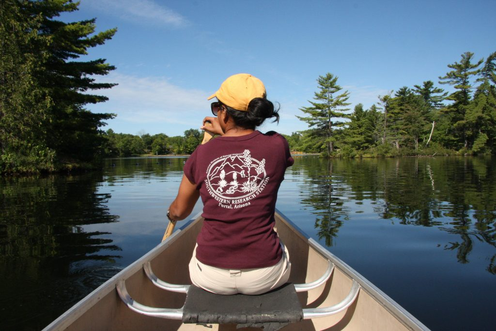 Thanushi canoeing for plankton samples on Six Mile Lake