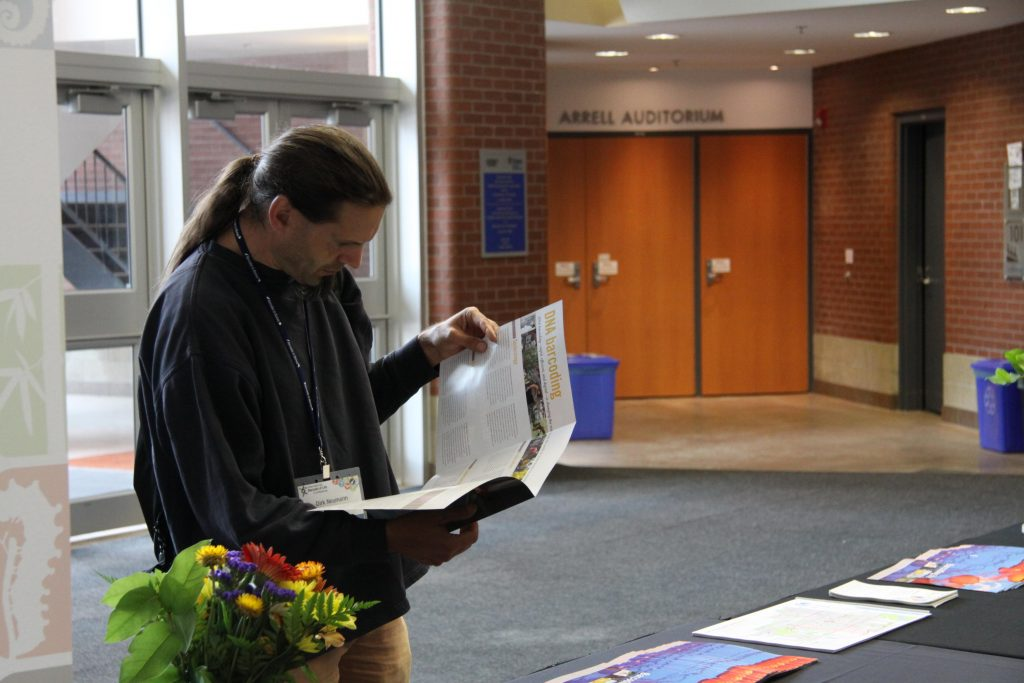 Dirk Neumann checking out a conference pamphlet